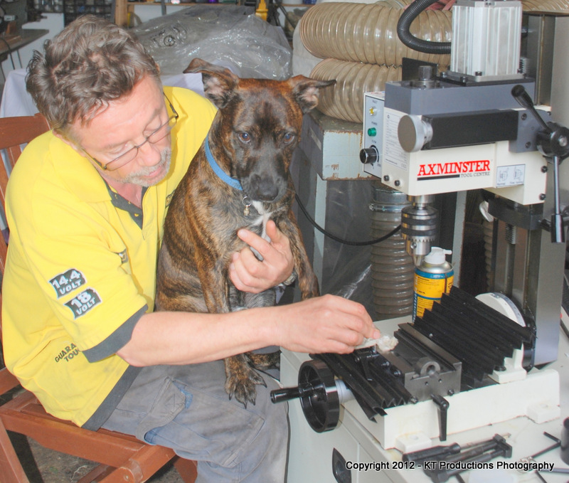 ALFIE cleaning off the gunk from the milling machine